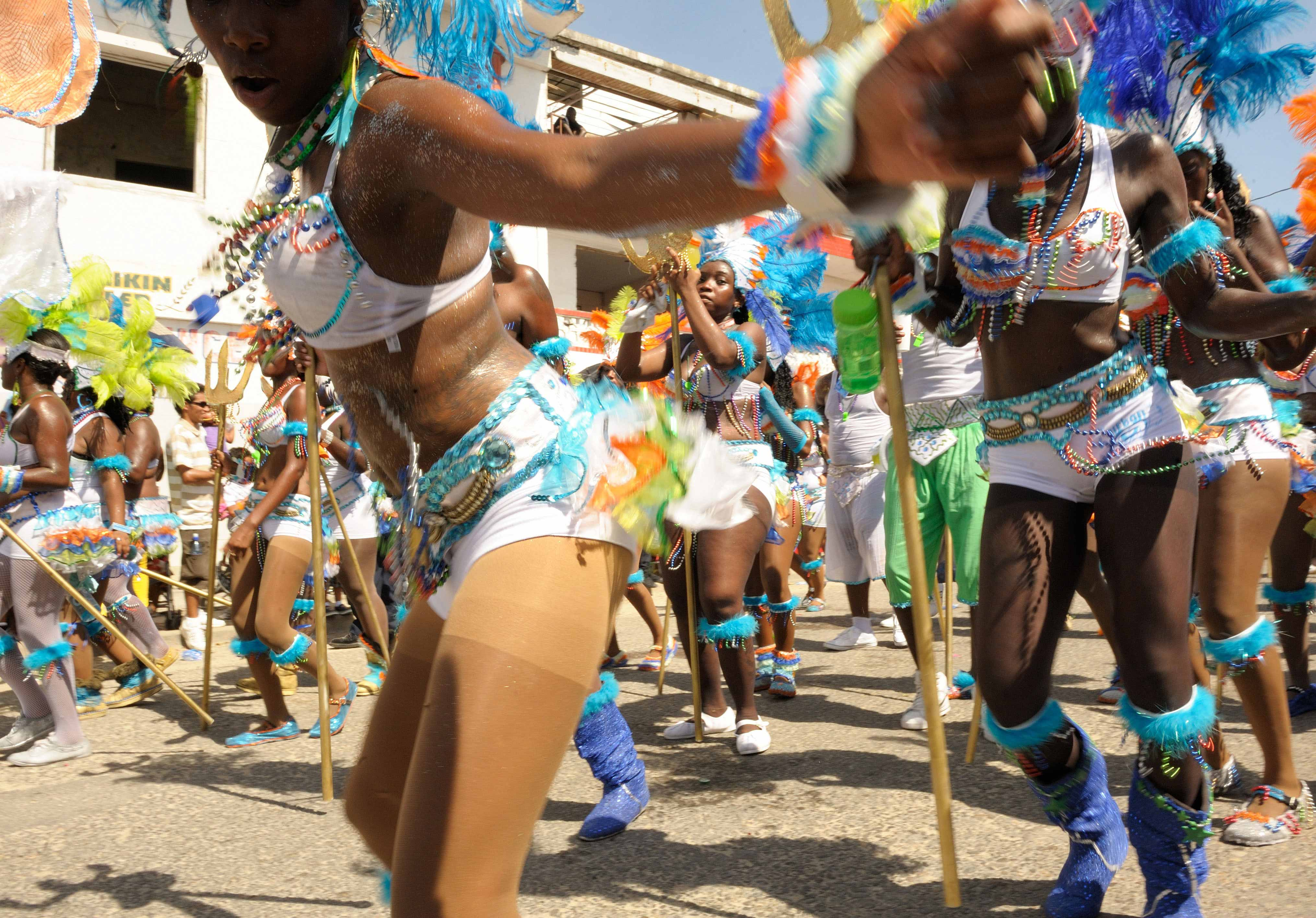 September in Belize heats up with Carnival and colorful costumes!!
