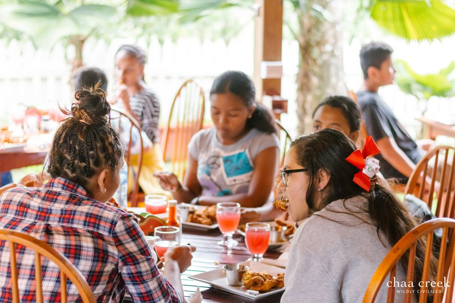 belize Christmas caroling 2018 kids eating at guava limb restaurant