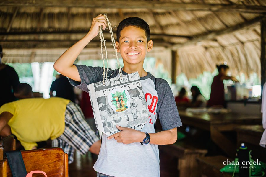eco kids summer camp 2019 day 7 boy posing with arts crafted handbag
