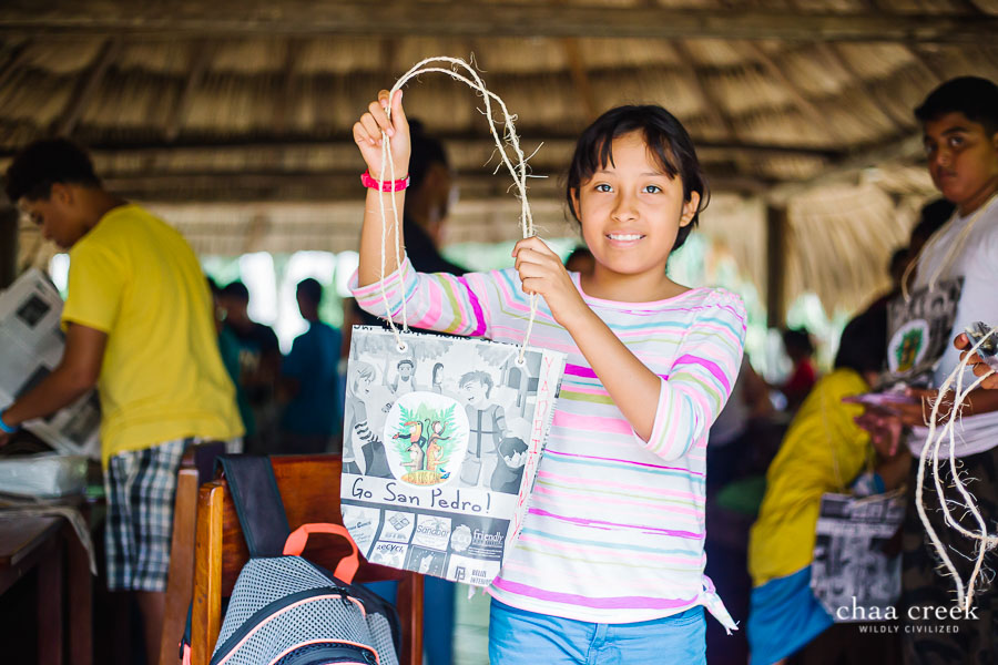 eco kids summer camp 2019 day 7 girl posing with crafts handbag