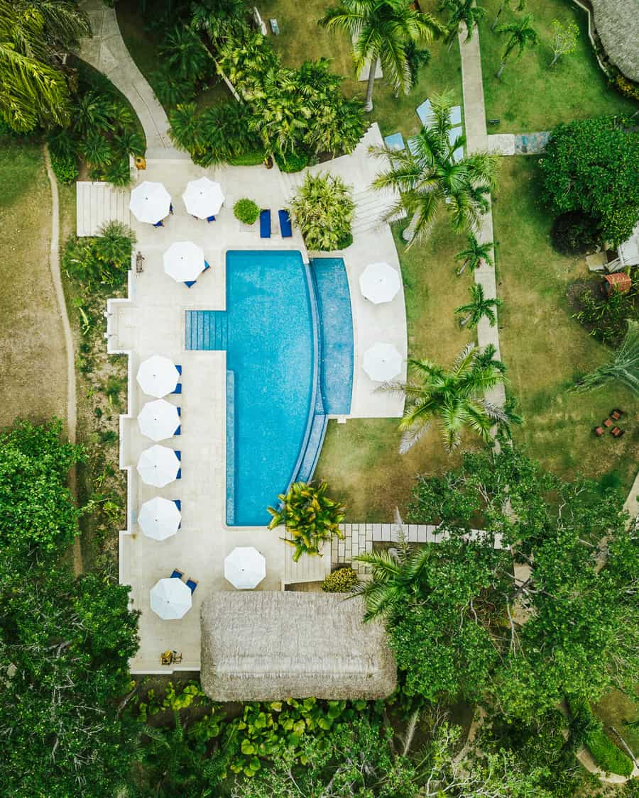 chaa creek swimming pool aerial shot of grounds
