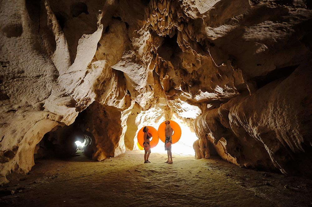 belize cave tubing romantic activities couple in cave with tubes