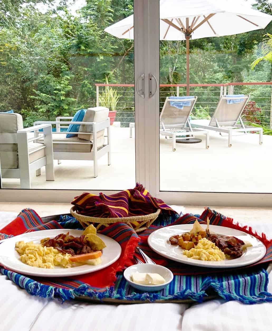 belize romantic getaways breakfast in bed at chaa creek villa